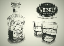 Stemware et bouteille avec le whiskey Image stock