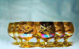 Stemware. A pyramid of glass glasses in gold Royalty Free Stock Image