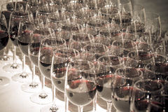 Stemware of red wine on a white table. Banquet. Toned Stock Image