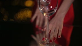 Stemware. Woman puts two wineglasses on the table for the night date stock footage
