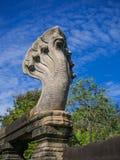 Sten för sand för sju huvudNaga som snider statyn på historiska Phimai Arkivfoton