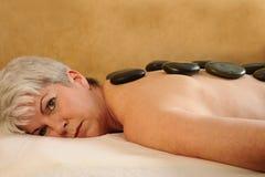 sten för varm massage för konditionhälsa hög Arkivbilder