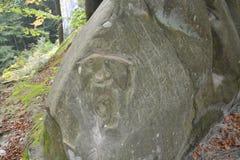 Sten med en bild av en framsida för person` s Royaltyfri Foto