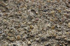 sten- och cementtexturbakgrund små flodstenar med cem Royaltyfria Foton