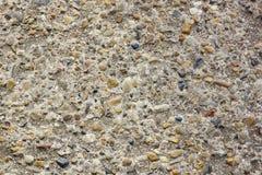 sten- och cementtexturbakgrund små flodstenar med cem Fotografering för Bildbyråer