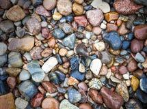 Sten- och kiselstenbakgrund för baltiskt hav. Royaltyfri Fotografi