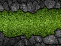 Sten på grön konstgjord torvamodell arkivfoto