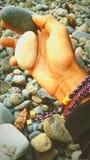 Sten på min hand arkivfoto