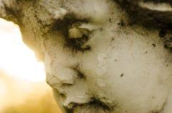 Sten sniden framsida av en kerub Fotografering för Bildbyråer
