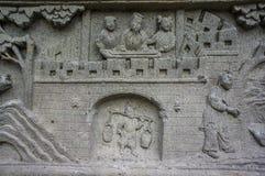 Stena att snida kinesisk konst runt om den thailändska templet i Wat Pichaya-yatogaram Royaltyfria Foton