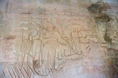 Stena att snida, lite varstans på väggen på Angkor Wat Royaltyfri Bild