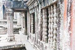 Stena att snida, lite varstans på väggen på Angkor Wat Arkivfoto