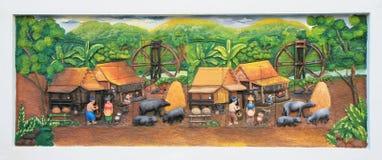 Stena att snida och att måla av traditionell thailändsk kultur arkivbild