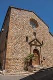 Stena den gjorda fasaden av den forntida kyrkan i Châteaudouble Fotografering för Bildbyråer