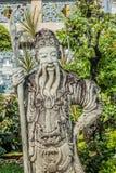 Stena den kinesiska förmyndarestatyWat Pho templet bangkok Thailand Arkivfoton
