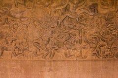 Stena snidit på väggen av Angkor Wat Arkivbild