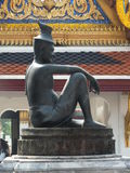Stena statyn i den Wat Pho templet i Bangkok, Thailand Royaltyfri Fotografi