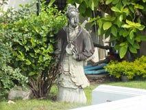 Stena statyn på Wat Pho tempeljordning i Bangkok, Thailand arkivfoton
