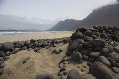 stenad strand Arkivbild