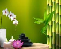 Stenar, blommor, vax och bambu på tabellen Arkivbilder