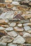 stenar den små stenen för abstrakt bakgrund texturväggen Royaltyfria Bilder