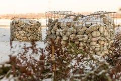 Stenar i burar Arkivbild