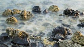 Stenar i havet Arkivfoto