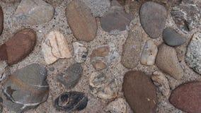 Stenar i konkret textur Arkivbild