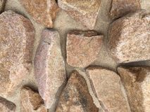 Stenar och sand arkivbild