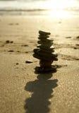 Stenar på aftonstranden Fotografering för Bildbyråer