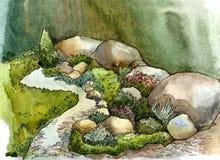 Stenar, stenblock, liten vik, gräs och blommor i landskapdesign royaltyfri fotografi