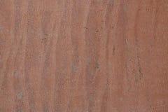 Stenarbete på naturlig röd stentextur arkivbild