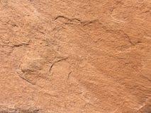 Stenbakgrund eller textur för gul brunt och tömmer utrymme Arkivbilder