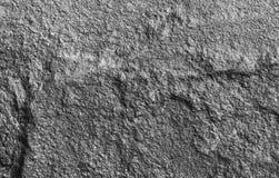 Stenbakgrundstextur av stenhällen som är svartvit Royaltyfri Foto