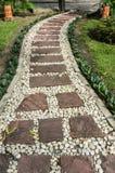 Stenbana i trädgården Arkivbild