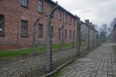 Stenbaracker i det tidigare koncentrations- och utrotninglägret Auschwitz-Birkenau i Polen Royaltyfri Fotografi
