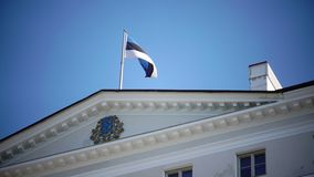 Close up of national flag of Estonia onThe Stenbock House, the building of the government and the State Chancellery of. The Stenbock House, the building of the stock footage