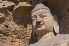 StenBuddhaskulptur i grottan Royaltyfri Foto
