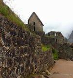 Stenbyggnader på Machu Pichu Arkivbilder