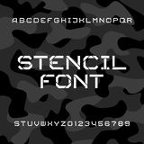 Stencil alphabet font. Tough type letters and numbers on a camo background. Stock Images