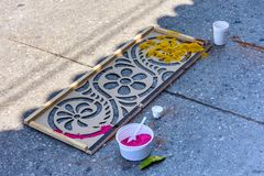 Stencil & dyed sawdust, Antigua, Guatemala. Antigua, Guatemala -  April 13, 2017: Stencil & dyed sawdust to make Holy Thursday procession carpet in town with Royalty Free Stock Photography
