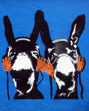 Stencil Graffiti Donkeys. BRISTOL - AUGUST 31: New graffiti piece of donkeys with headphones as Bristol City Council asks public to vote whether graffiti be left Royalty Free Stock Photos