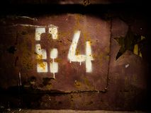 Stencil number. Old style stencil numbers rusty metal grunge background Stock Photography