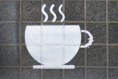 Stencil på asfalt Arkivbilder