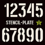 Stencil-plate numbers in military style. Bold face. White  print on black background Stock Photography