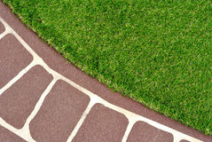 Stenciled Concrete Floor and Green Artificial Grass Royalty Free Stock Photo
