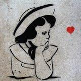 Stencilgrafittiflicka, Prague Arkivfoton