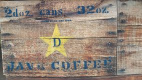 Stencilled Wooden Crate of Java Coffee cans royalty free stock images
