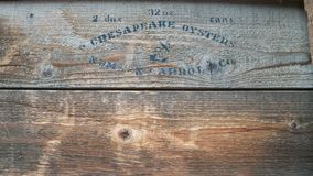 Stencilled Wooden Crate of Oysters in Tins royalty free stock photo