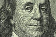 Stående av Benjamin Franklin på den hundra dollarräkningen Arkivfoto
